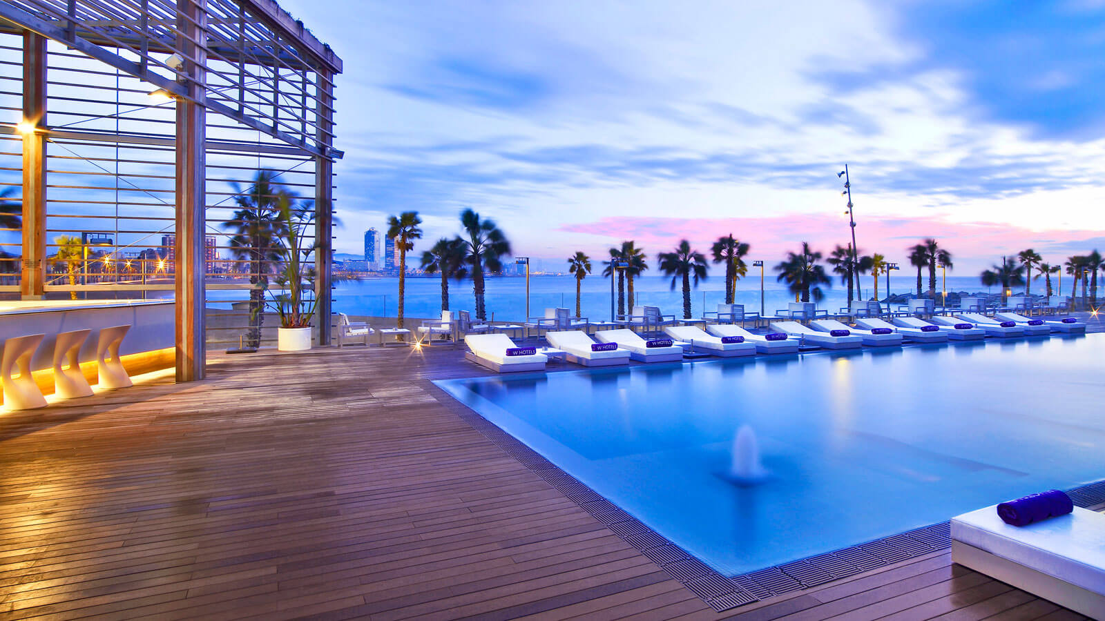 Astounding Outdoor Relaxing E Design Lied Inside W Hotel Barcelona Near Several Clear Colored Beach Chaises Along With Wide Blue Pool